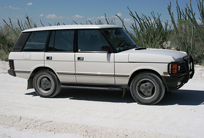White Range Rover on a white dirt road