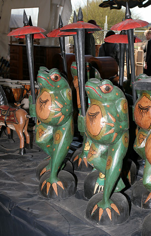 Army of carved wooden frogs