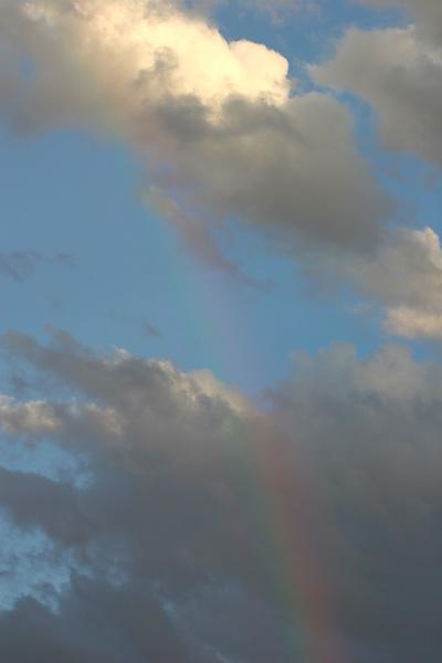 Rainbow in a partly cloudy sky